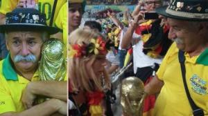 saddest-man-in-brazil-hands-over-trophy-to-german-136391834620010401-140709175146